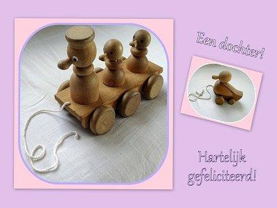Dochter, houten speelgoed (Ansichtkaart)